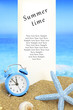 Summer time. White banner and alarm clock on the beach