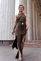 Girl runs along the columns