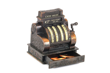 Vintage brass miniature cash register isolated on white