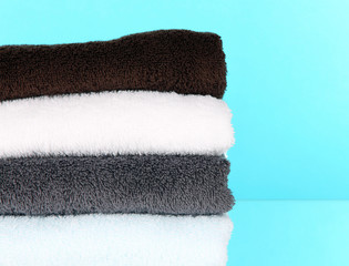 Bath towels on blue background