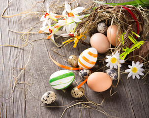 Colorful easter eggs with brown basket