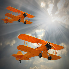 Old biplanes on the sky.