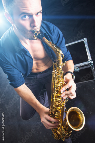 Young man playing the Saxophone.