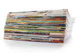 A large stack of magazines. On a white background with shadow.