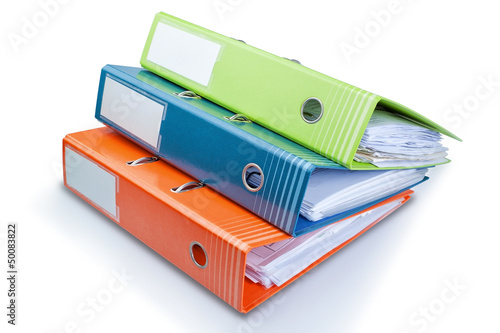 Stationery Office folder on the table with papers. On a white ba