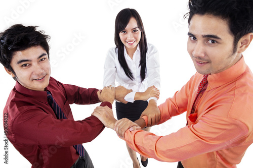 Business teamwork hold hands