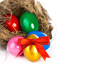 Colorful Easter eggs in a nest from branches on  white backgroun