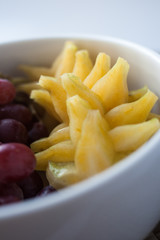 grape and starfruit in a bowl