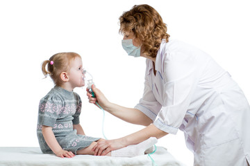 Doctor holding inhaler mask for kid breathing, hospital