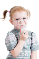 kid girl holding inhaler mask