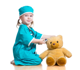 doctor girl playing and measuring  temperature toy isolated on w