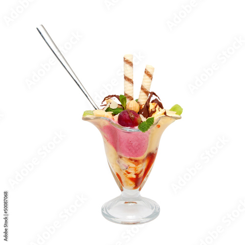 Ice cream with fruits and syrup, decorated with mint