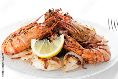 Jumbo prawns and grilled squids with black rice isolated on whit