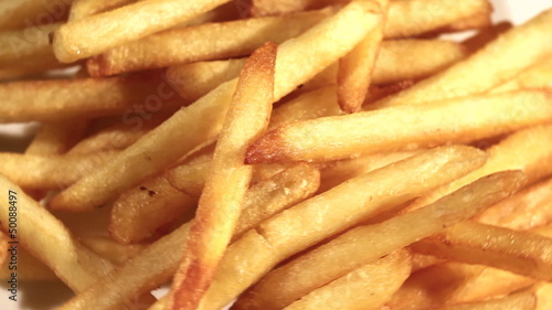 The plate with French fries rotates. Top view