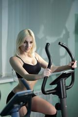beauty girl on bicycle exercise