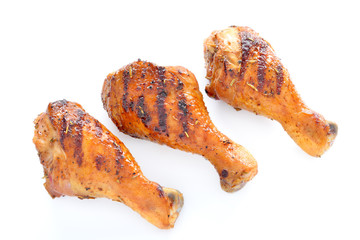 Grilled chicken leg on white background.