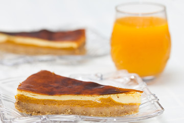 A slice of cheesecake with pumpkin