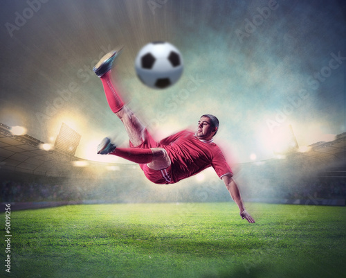 Staande foto Voetbal football player striking the ball