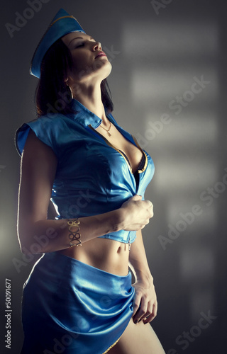 sexy beauty stewardess in blue uniform