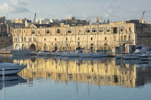 water reflection of old warehouse in Senglea marina in front  Vittoriosa, Malta