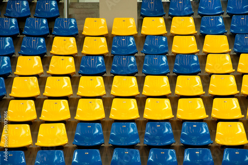 Seats in basketball stadium .