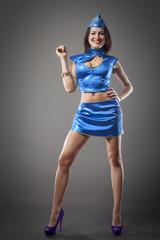 sexy stewardess in blue uniform