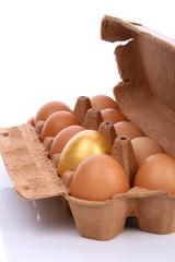 Golden egg in a box
