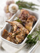 roasted rabbit with herbs and garlic, selective focus