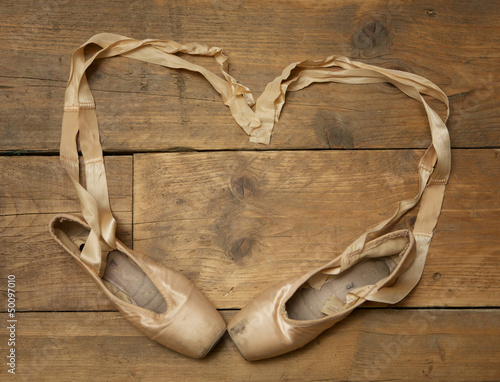 Pair of Ballet Shoes on Wooden Floor