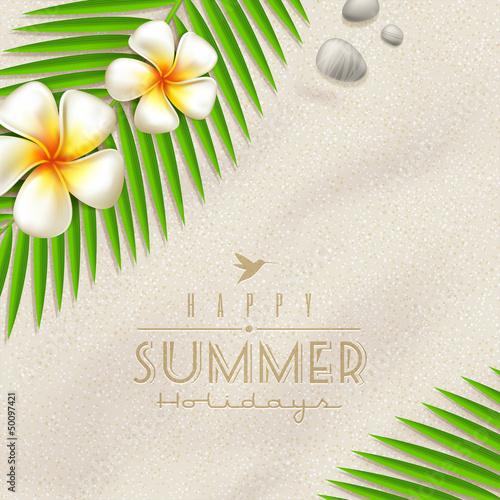 Tropical flowers and  palm tree branches on a beach sand