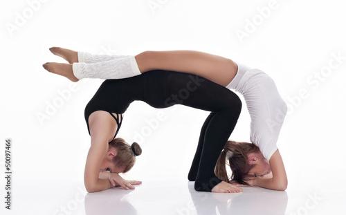 Plexiglas studio shoot of two cute woman gymnasts