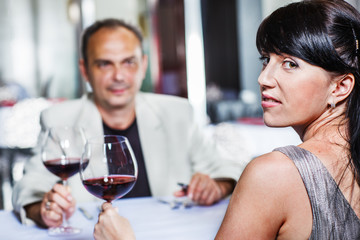 Woman and her husband  in a restaurant