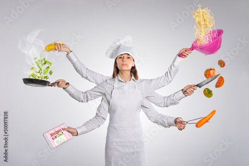 Woman chef pointing empty blank copy space isolated on white