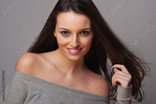 Smiling brunette woman intense close up portrait.