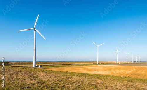 Row of modern wind turbines in a rural landscape