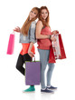 Two girls with shopping bags. Isolated over white background.