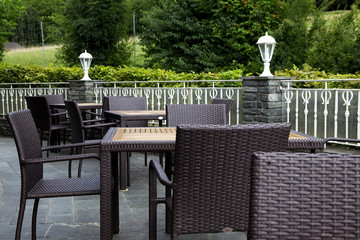 Beautiful restaurant on terrace near woods.