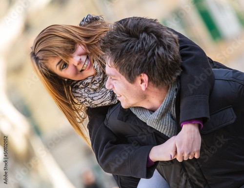 Happy Man Holding his Girlfriend Piggyback
