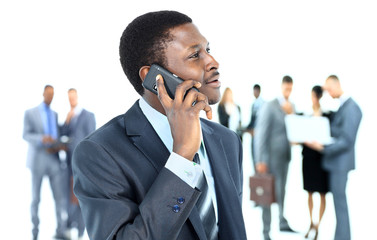 Smiling handsome business man using cell phone