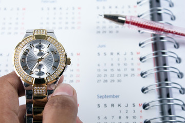 business time concept with watch, calendar, and note