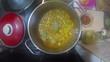 Chef Adding Bay Leaf To Chicken Stew