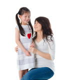 korean mother and her daughter with isolated background during m
