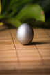 Silver Easter egg on wooden background