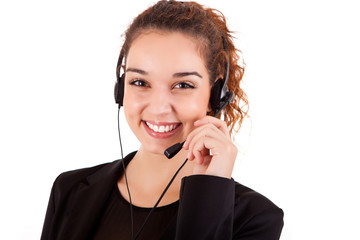 Portrait of a happy young call center employee smiling with a he