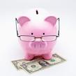 Tirelire avec lunettes sur billets dollar US