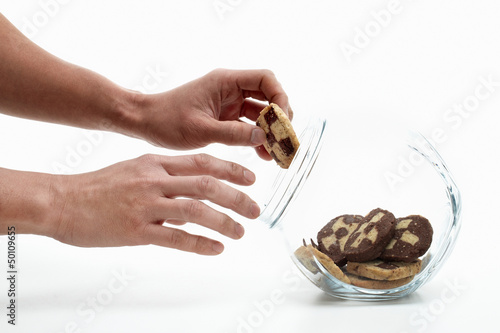 Two hands steeling cookies
