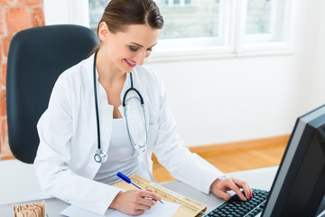 doctor at desk in clinic writing a file or dossier