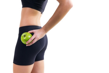 woman in fitness clothes holding an apple