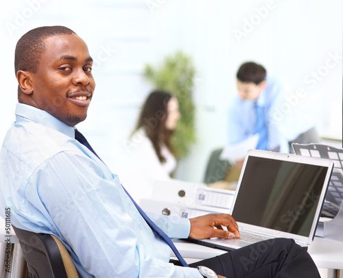Portrait of  entrepreneur displaying computer laptop