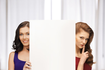 two women with blank board